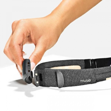 Female touching muse s device