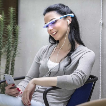 woman-relaxing-with-ayo-light-therapy-wearable-glasses